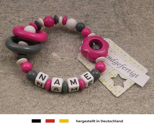 Greifling geschlossen mit Wunschnamen Motiv Blume in pink