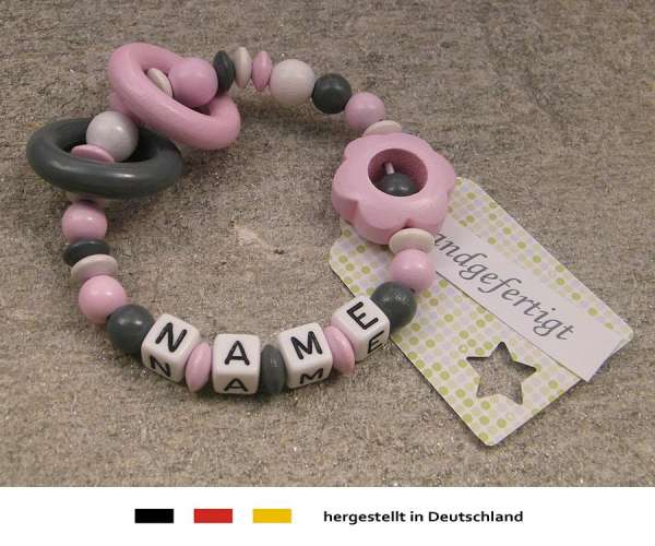 Greifling geschlossen mit Wunschnamen Motiv Blume in rosa